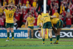 Wallabies' James O'Connor, second from right, consoles Kurtley Beale after he missed a penalty goal against British and Irish Lions in their rugby test match in Brisbane, Australia. Photo / AP.