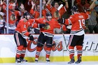 Chicago defenceman Patrick Kane, centre, scored two of the Blackhawks' goals in game five against the Boston Bruins. Photo / AP