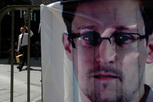 A banner supporting Edward Snowden, a former CIA employee who leaked top-secret documents about sweeping U.S. surveillance programs, is displayed in a Hong Kong shopping mall. Photo / AP