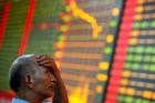 China's Shanghai Index plunged more than 5 per cent in afternoon trading as investors dumped stocks on fears of a liquidity crunch in the country's banking system. Photo / AP