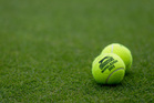 Tennis balls emblazoned with Wimbledon 2013 - and featuring NZ wool - are placed on a court during a match. Photo / AP
