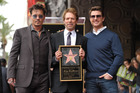 Johnny Depp, from left, Jerry Bruckheimer, and Tom Cruise appear at a ceremony honouring Bruckheimer with a star on the Hollywood Walk of Fame in Los Angeles. Photo / AP