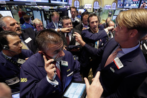 US traders have dumped stocks, bonds and commodities, prompted by signs of distress in China's economy. Photo / AP