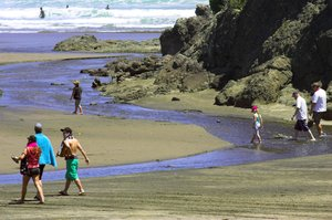 The lagoon at South Piha triggered 22 red alerts for bacteria levels over summer. Photo / Getty Images
