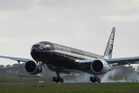 Air New Zealand's newest Boeing 777-300ER arrived in Auckland this morning, the plane is the largest commercially operated aircraft to be painted black. 12 January 2012 New Zealand Herald Photograph b