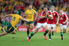 Lions winger George North steps round Berrick Barnes on his way to scoring his wonder try at Suncorp Stadium last week. Photo / Getty Images