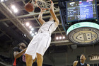 Adams dunks the ball during an NCAA game for Pittsburgh against Delaware State. Photo / AP