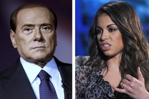 "Ex-Italian Prime Minister Silvio Berlusconi (L) and Karima El Mahroug (""Ruby""). He's been found guilty of paying for sex with an underage girl - but his legal woes don't end there. Photo / AFP"