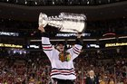 Jonathan Toews of the Chicago Blackhawks hoists the Stanley Cup Trophy after his team defeated the Boston Bruins in Game Six of the 2013 NHL Stanley Cup Final. Photo Getty Images