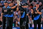 New Zealand's players celebrate the wicket of England's Eoin Morgan. Photo / AP