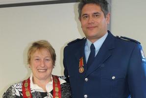 Constable Aaron Redaelli was presented with the Bronze Medal for bravery by Queenstown Lakes Mayor Vanessa van Uden. Photo / James Beech