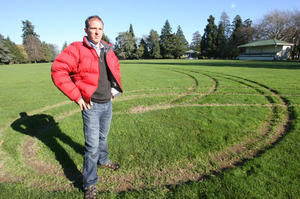 Charlie Fairbairn, property and facilities officer for Masterton District Council, on the vandalised park oval. Photo / Lynda Feringa