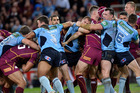 Queensland and New South Wales players fight during State of Origin II. Photo / Getty Images