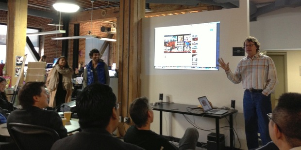 Jeff Smith, right, talking to media at Smule's San Francisco office. Chief scientist Parag Chordia is standing at left in the blue jacket.