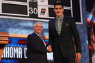 Steven Adams shakes the hand of outgoing NBA commissioner David Stern after being drafted by the Oklahoma City Thunder. Photo/AP