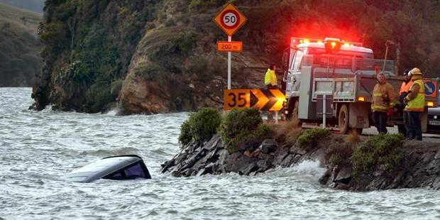The van sits in Otago Harbour after going off Portobello Rd at Edwards Bay. Photo / Otago Daily Times