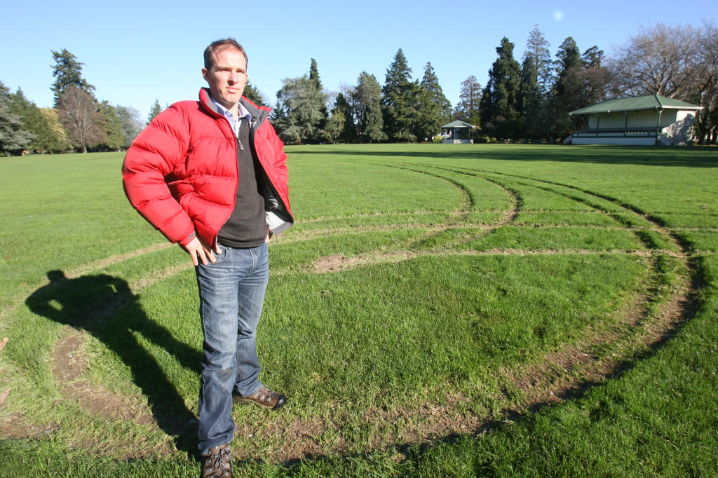 wta240613lfcharlie.jpg Masterton District Council property and facilities officer Charlie Fairbairn t next to car skid marks on the Queen Elizabeth Park Oval.