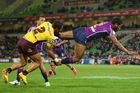 Sisa Waqa of the Storm is tackled by Josh Hoffman of the Broncos. Photo / Getty Images