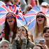 Spectators watch the giant screen as Andy Murray of Britain plays Fernando Verdasco of Spain in a Men's singles quarterfinal match at the All England Lawn Tennis Championships in Wimbledon. Photo / AP