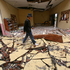A man walks past a school destroyed by Tuesday's earthquake in Blang Mancung, Aceh province, Indonesia. Photo / AP