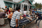 Earthquake victims receive medical treatment outside a community health centre in Bener Meriah, Aceh province, Indonesia. Photo / AP