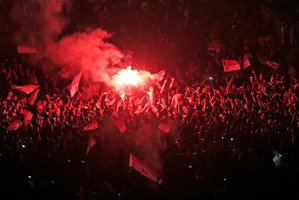 Opponents of Egypt's Islamist leader Mohammed Morsi celebrate outside the presidential palace in Cairo, Egypt. Photo / AP