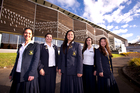 Epsom Girls Grammar students, from left, Lucy Sheffield, Tui Turnwald, Arizona Leger, Claudia Boyo and Eva Ding outside stage one of the new sports facility. Photo / Dean Purcell