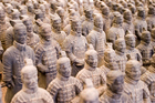 Some supportive wife duties were still filled, even from 11,000km away visiting China's terracotta army. Photo / Getty Images