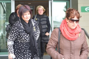 Anna Osborne (L), Cheryl Griffin (R) and Lynne Sims - who all lost loved ones in the mining disaster - leaving the Greymouth District Court after yesterday's sentencing. Photo / Greymouth Star