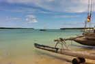 A traditional proa, or fishing boat, off the Isle of Pines; the tiny islet of Kotomere. Photo / Lydia Jenkin
