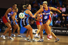 Julie Corletto (right) is still playing for Australia despite plying her trade with the Northern Mystics. Photo / Getty Images
