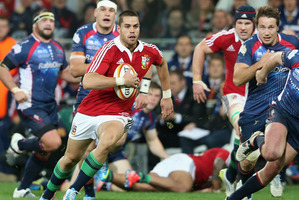 Sean Maitland, left, on the break for the British and Irish Lions against the Rebels. Photo / Getty Images