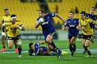 Tony Woodcock makes a break during last night's match against Hurricanes in Wellington. Photo / Getty Images