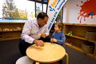 Kevin Christie shares morning tea with 3-year-old Lane Currie at Footsteps in Papakura. Photo / Dean Purcell