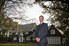 Mark Fraser of Hobsonville Land Company in front of Mill House. Photo / Greg Bowker