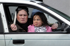 Nikayla Hawea and daughter Zania with the knife thrown at their car. Photo / Stuart Munro