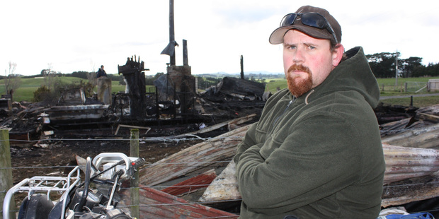Dannevirke's Owen Reynolds at the scene of the fire which destroyed his family home. Photo / Christine McKay