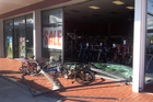 The Bicycle Business premises after a car careered through its front window. Photo / Joel Ford