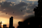 Military helicopters trail the national flag in the skies over Cairo. In the streets, drivers honked their horns and waved flags out of their windows. Photo / AP