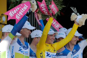 Stage winner team Orica Greenedge with Simon Gerrans of Australia, wearing the overall leader's yellow jersey, celebrates on the podium of the fourth stage of the Tour de France. Photo / AP