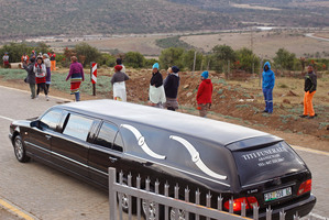 A hearse escorted by police arrives at the home of Mandla Mandela, the grandson of Nelson Mandela, to collect remains in Mvezo, South Africa. Photo / AP