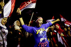 Opponents of Egypt's Islamist leader Mohammed Morsi celebrate outside the presidential palace in Cairo. Photo / AP