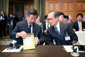 Japanese Deputy Minister of Foreign Affairs Koji Tsuruoka, left, and Ambassador of Japan to the Netherlands Yasumasa Nagamine at the hearing at The Hague. Photo / AP