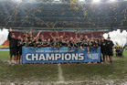 The New Zealand men's and women's sevens sides with their trophies after winning the Rugby Sevens World Cups at Luzhniki stadium in Moscow. Photo / AP