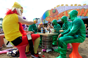 Colourful patrons enjoy the food offerings at Glastonbury.Photo / AP