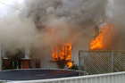 A  32-year-old woman perished in this house fire in Wanganui in December. Photo / Wanganui Chronicle