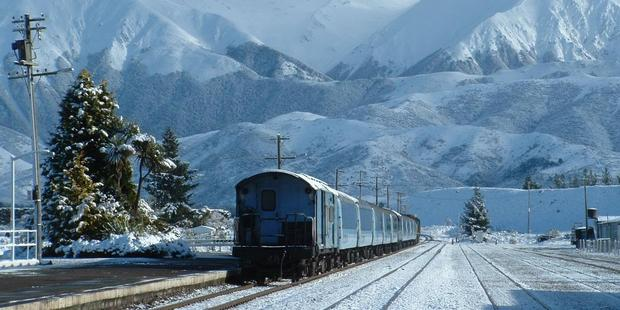 The TranzAlpine amid the grandeur of the Southern Alps at Springfield Station. Photo / Tranz Scenic