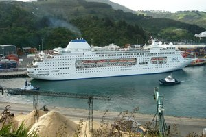 A cruise ship with tug boats in Port Chalmers. Photo / File / Donald Stanger