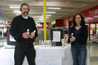 Anti-fluoride campaigners Mark Atkin and Mary Byrne offer free bottles of artesian water at Wainuiomata Mall. Photo / Jamie Adams