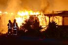 Fire crews battle the blaze at Albany. Photo / SNPA